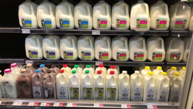 milk at the amazon's whole foods grocery store in chattanooga, tennessee. amazon bought whole foods for $13.2 billion in 2017 and has over 500... - protein drink stock videos & royalty-free footage