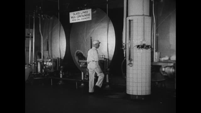 milk being pasteurized in large vats rolling over turning rods cu rods turning w/ milk milk bottles being capped milk wagons in row at night milkmen... - milkman stock videos & royalty-free footage