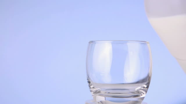 milk being poured from plastic bottle to glass - milk bottle stock videos & royalty-free footage