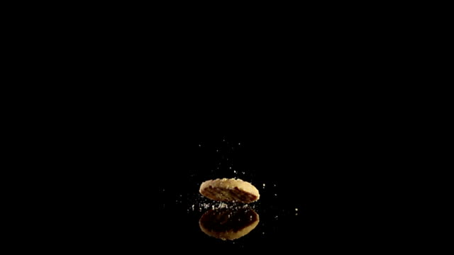 milk cookie drop in slow-motion - biscuit stock videos & royalty-free footage