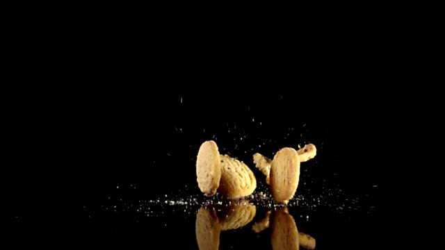 milk cookies drop in slow-motion - cracker stock videos and b-roll footage