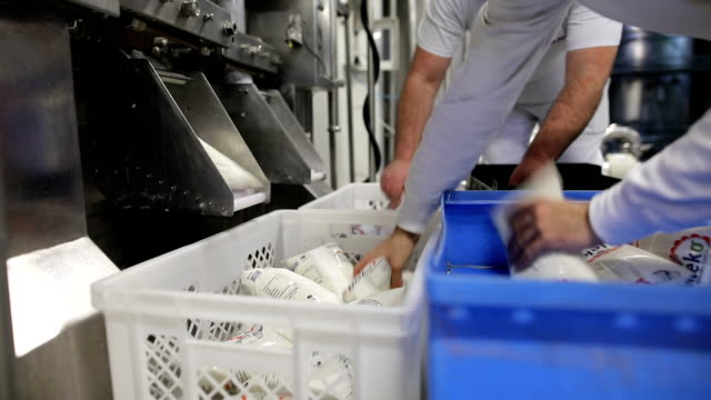 milk in a clear plastic bag.fresh dairy products.hands receive ready bags with dairy products - crate stock videos & royalty-free footage