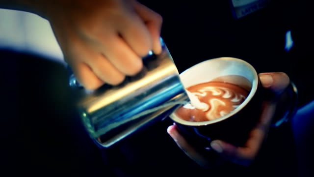 Milk pouring by a Barista.