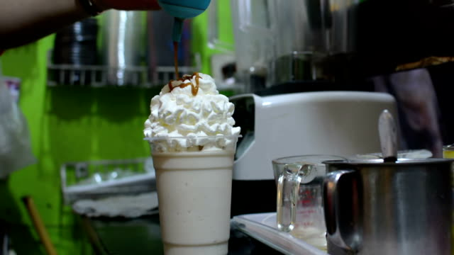 milk smoothie with whipped caramel - whipped food stock videos and b-roll footage