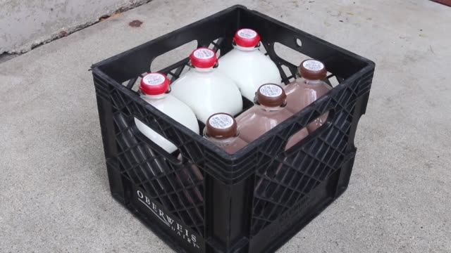 milkman delivering dairy items to various stops along his route in arlington heights illinois milkman opens coolers on front porches and replaces... - milkman stock videos & royalty-free footage