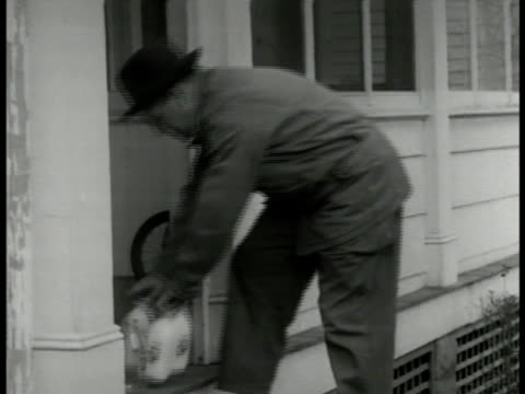 milkman 'ed hill' out of milk truck delivering bottles ms hill setting milk cans on house porch ws hill back into truck driving off residential... - milkman stock videos & royalty-free footage