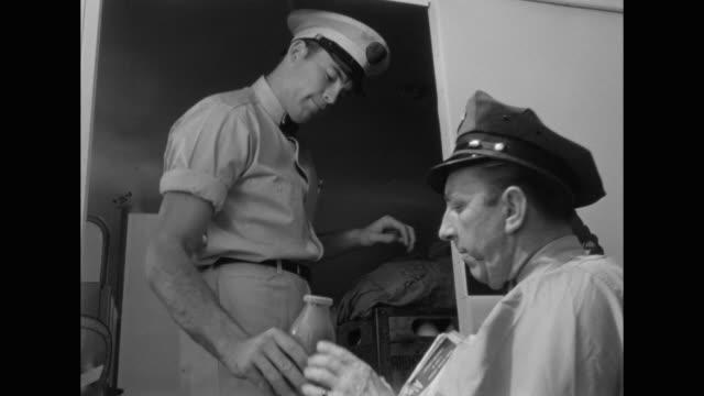 1948 milkman sells chocolate milk to postman - chocolate milk stock videos & royalty-free footage