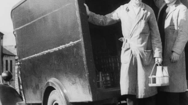 montage milkmen delivering bottled milk to homes by truck / united kingdom - dairy product stock videos and b-roll footage