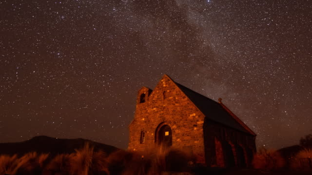 milky way over church of the good shepherd with clear sky, milky way time lapse - southern hemisphere stock videos & royalty-free footage