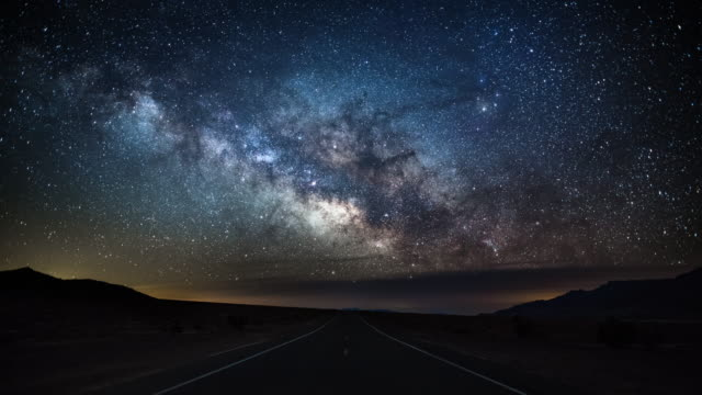 milky way over country road - death valley, usa - 4k nature/wildlife/weather - esplorazione video stock e b–roll