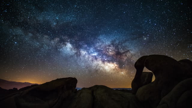 time lapse: milky way over mobius arch in california, usa - arch architectural feature stock videos and b-roll footage
