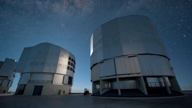 milky way over the domes of the very large telescope (vlt), timelapse video. - mirror object stock videos & royalty-free footage