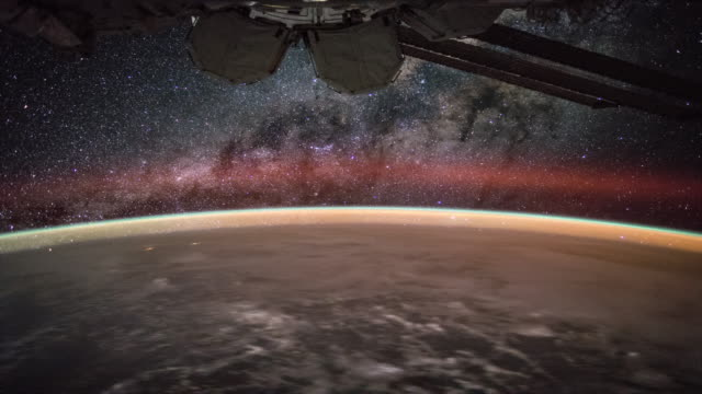 milky way over the earth seen from iss 4k - digital composite stock videos & royalty-free footage