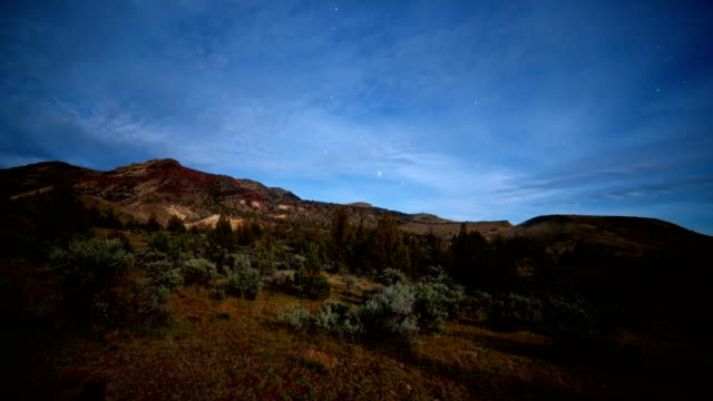 Milky way rise over desert mountain over moonset western juniper sage brush near john day fossil beds sutton mountain