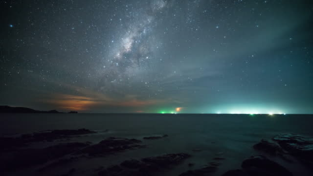 milky way time lapse on the ocean, sabah, malaysia - nautical vessel video stock e b–roll