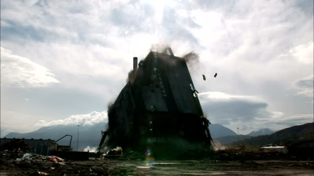 vidéos et rushes de ws mill building as it is demolished in  controlled implosion using explosives  / fort william, scotland, uk - imploding