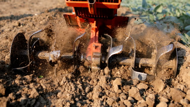 mill of ploughing tiller in the soil - agricultural equipment stock videos & royalty-free footage