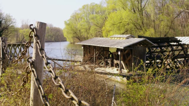 mill on tranquil sunny river, real time - watermill stock videos and b-roll footage