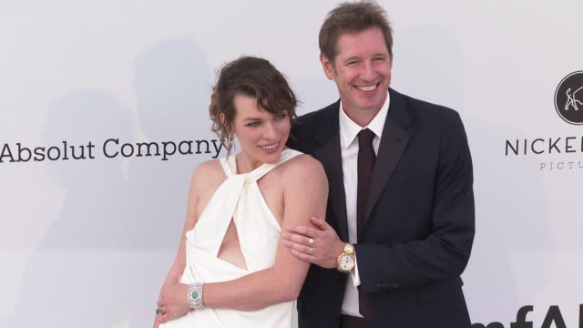 Milla Jovovich and Paul W S Anderson at the amfAR Cannes Gala 2019 Arrivals at Hotel du CapEdenRoc on May 23 2019 in Cap d'Antibes France
