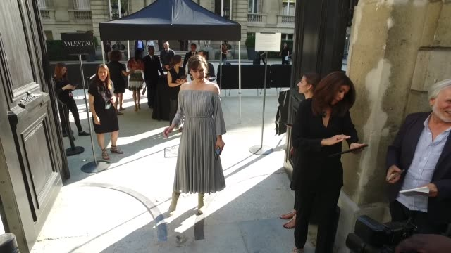 milla jovovich arrives for the valentino fashion show paris fashion week haute couture fall/winter 2016 2017 day 4on july 6 2016 in paris france - milla jovovich stock videos and b-roll footage