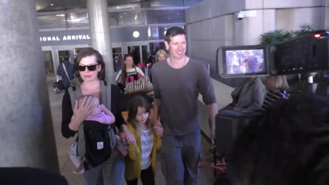 milla jovovich arriving at lax airport in los angeles celebrity sightings on december 16 2015 in los angeles california - milla jovovich stock videos and b-roll footage