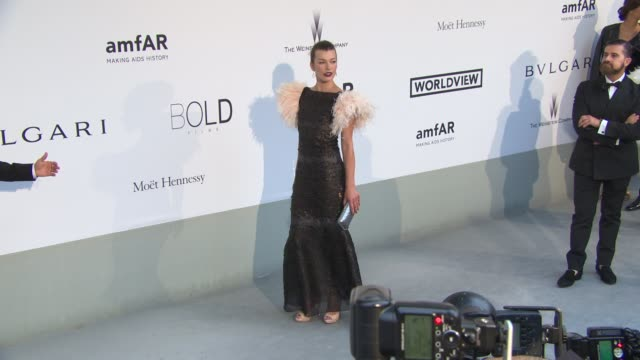 milla jovovich at amfar red carpet at hotel du capedenroc on may 22 2014 in cap d'antibes france - milla jovovich stock videos and b-roll footage