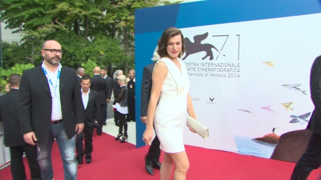 broll milla jovovich at 'cymbeline' red carpet 71st venice international film festival at palazzo del cinema on september 03 2014 in venice italy - milla jovovich stock videos and b-roll footage