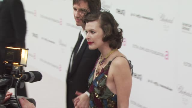 milla jovovich at the 18th annual elton john aids foundation oscar party at west hollywood ca. - oscar party stock videos & royalty-free footage