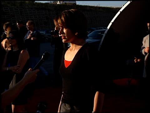 Milla Jovovich at the 1998 MTV Movie Awards at Barker Hanger in Santa Monica California on May 30 1998