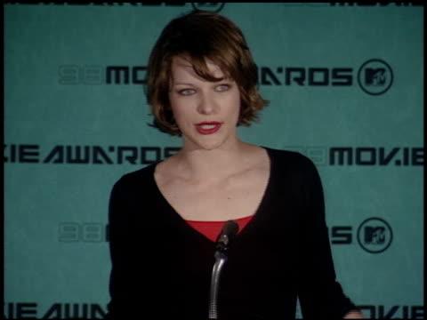 Milla Jovovich at the 1998 MTV Movie Awards Pool Feed at Barker Hanger in Santa Monica California on May 30 1998