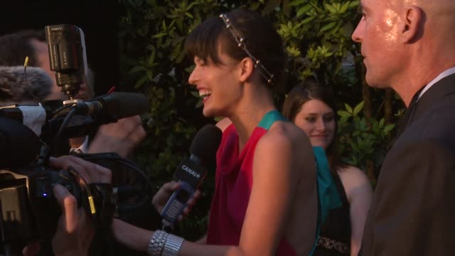 milla jovovich at the cannes amfar's cinema against aids 2008 arrivals at cannes - milla jovovich stock videos and b-roll footage