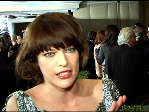milla jovovich at the clive davis' pregrammy awards party interviews at the beverly hilton in beverly hills california on february 13 2005 - milla jovovich stock videos and b-roll footage
