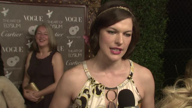 milla jovovich at the the art of elysium's 2nd annual black tie charity gala 'heaven' at los angeles ca - milla jovovich stock videos and b-roll footage