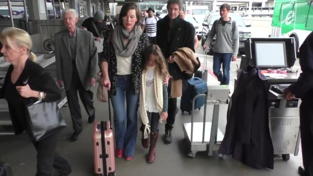 milla jovovich departing at lax airport in los angeles in celebrity sightings in los angeles - milla jovovich stock videos and b-roll footage
