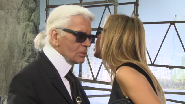 Milla Jovovich Karl Lagerfeld Vanessa Paradis at Paris Haute Couture Chanel at Grand Palais on July 02 2013 in Paris France