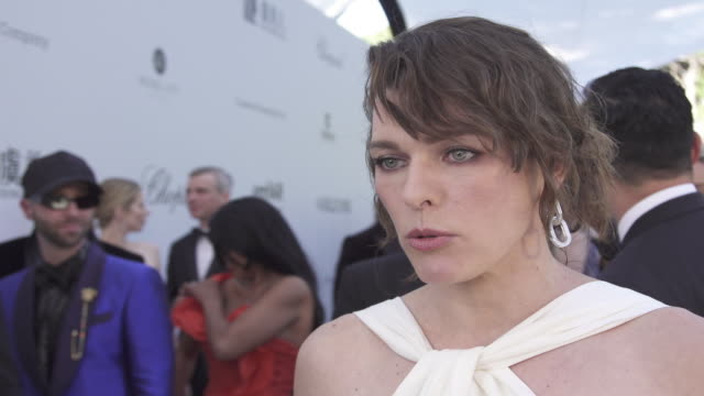 INTERVIEW Milla Jovovich on all the good that comes from the amfAR event at the amfAR Cannes Gala 2019 Arrivals at Hotel du CapEdenRoc on May 23 2019...