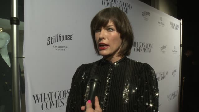 vídeos de stock, filmes e b-roll de interview milla jovovich on being here on what she loves about this store on her most coveted vintage piece at what goes around comes around beverly... - milla jovovich
