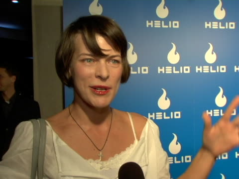 milla jovovich on her new clothing line the shirts she designed especially for helio and the helio launch party at the helio launch event at private... - milla jovovich stock videos and b-roll footage