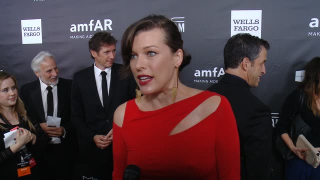 vídeos de stock, filmes e b-roll de interview milla jovovich on why she wanted to support amfar talks the countdown to a cure initiative and how tom ford inspired her at amfar... - milla jovovich