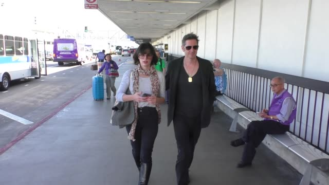 milla jovovich paul ws anderson departing at lax airport in los angeles in celebrity sightings in los angeles - milla jovovich stock videos and b-roll footage