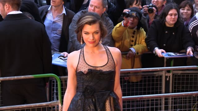 vídeos de stock, filmes e b-roll de milla jovovich poses for photos at the arrivals for gorby 80 at the royal albert hall milla jovovich at royal albert hall on march 30 2011 in london... - milla jovovich