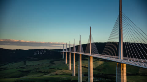 millau viaduct at sunset - time lapse - tal stock-videos und b-roll-filmmaterial
