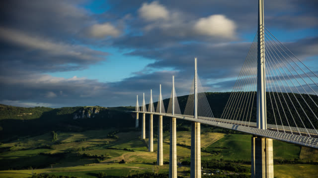 millau viaduct in late afternoon - time lapse - film composite stock videos & royalty-free footage