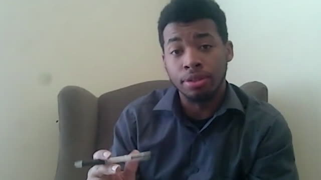 a millennial african-american man working from home converses while on a video call. - webcam stock videos & royalty-free footage