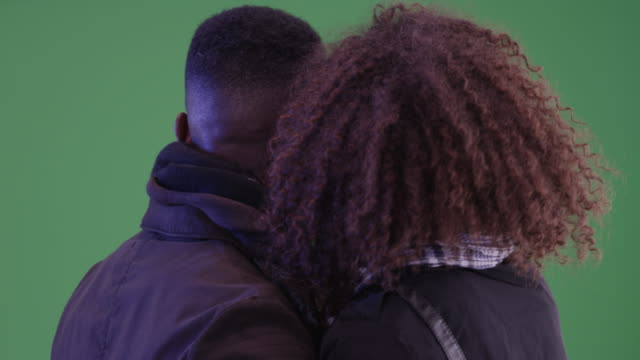 Millennial black couple travel to a new city on green screen