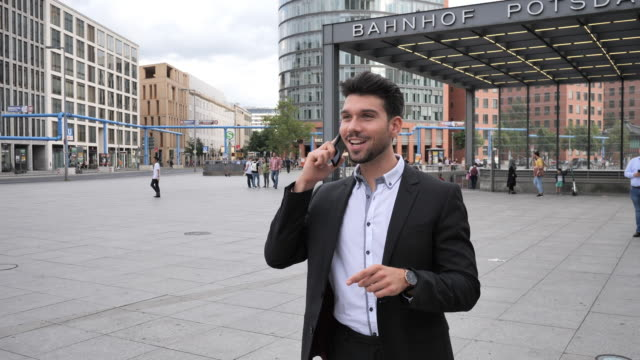 millennial businessman near subway and train station in germany - full suit stock videos & royalty-free footage