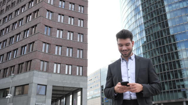 millennial businessman sending text message - full suit stock videos & royalty-free footage