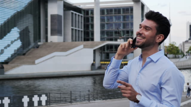 millennial businessman using phone for business plannings - full suit stock videos and b-roll footage