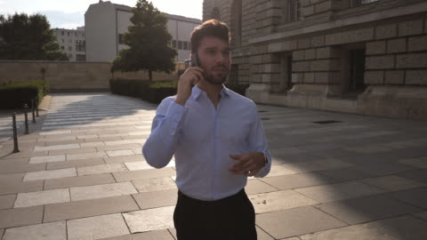 millennial businessman using phone for business plannings - full suit stock videos & royalty-free footage