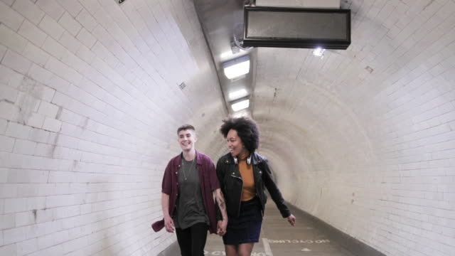 millennial friends running through tunnel - lgbtqi people stock videos & royalty-free footage